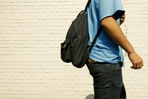 headless teen with backpack