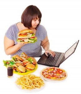 13309556-woman-eating-fast-food-at-work-isolated