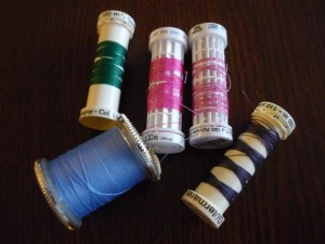 nearly-empty-spools-of-thread-and-old-thread-e1290494253202
